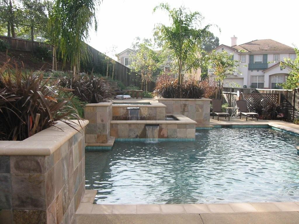 Terraced Pool Separate Seating Next To Spa Built In Seating Hang Out With Spa Water Features Pool Patio Built In Seating Spa Water Backyard landscaping ideas with swim spa